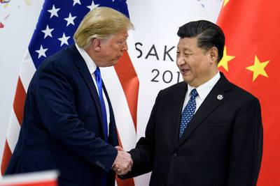 In this file photo taken June 28, 2019, China's President Xi Jinping, right, shakes hands with President Donald Trump before a bilateral meeting on the sidelines of the G20 Summit in Osaka.