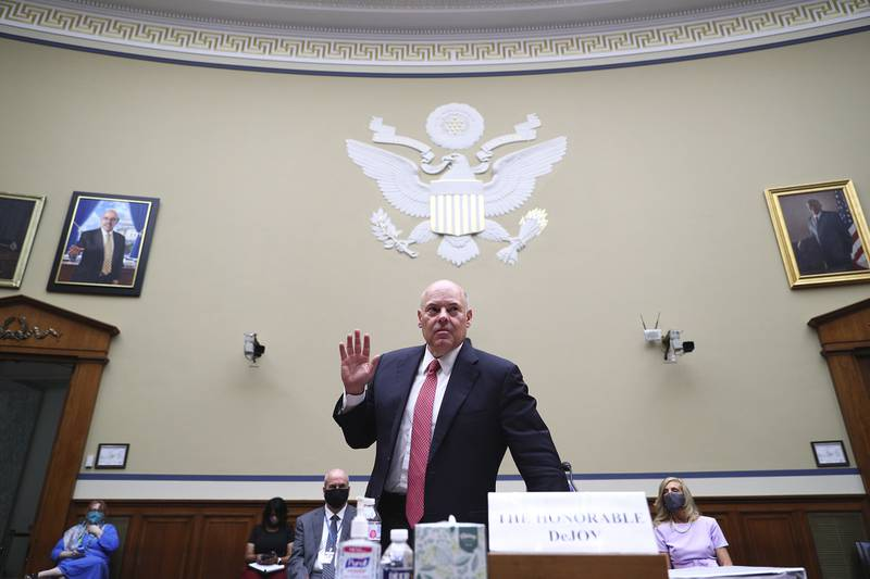 Postmaster General Louis DeJoy is sworn in before testifying before a House Oversight and Reform Committee hearing on the Postal Service on Capitol Hill, Monday, Aug. 24, 2020, in Washington.