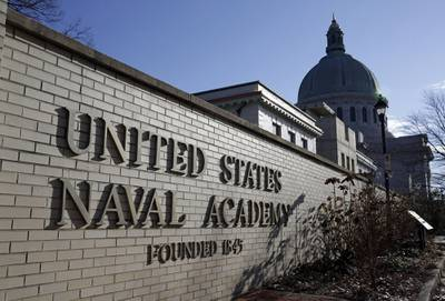 A sign stands outside of an entrance to the U.S. Naval Academy campus in Annapolis, Md., on Jan. 9, 2014.
