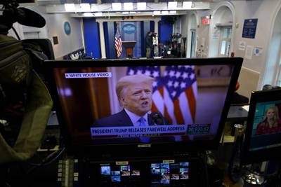 President Trump is seen on a network monitor after his pre-recorded farewell speech was released, inside the Brady Press Briefing Room at the White House, Tuesday, Jan. 19, 2021, in Washington.