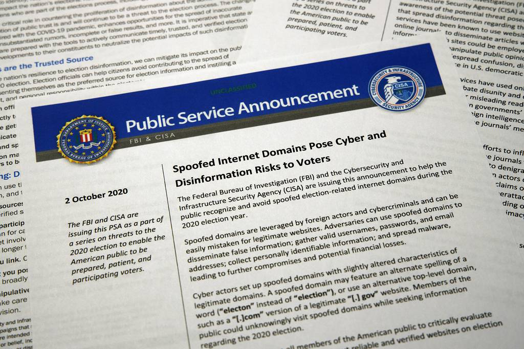 A public service announcement from the FBI and the Department of Homeland Security cybersecurity agency is photographed Tuesday, Oct. 6, 2020.