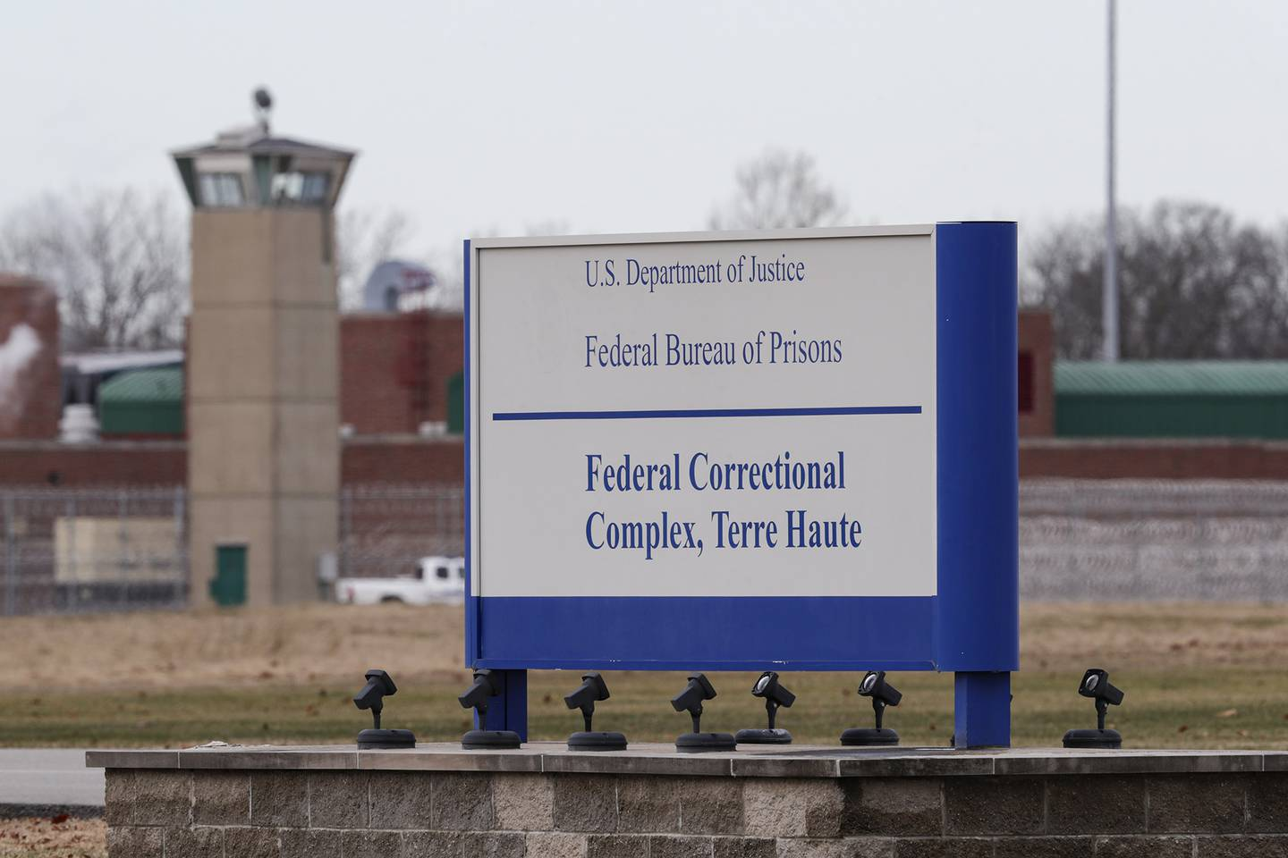 In this Dec. 10, 2019, file photo the guard tower flanks the sign at the entrance to the U.S. Penitentiary in Terre Haute, Ind.