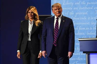 President Donald Trump stands on stage with first lady Melania Trump after the first presidential debate with Democratic presidential candidate former Vice President Joe Biden Tuesday, Sept. 29, 2020, at Case Western University and Cleveland Clinic, in Cleveland.