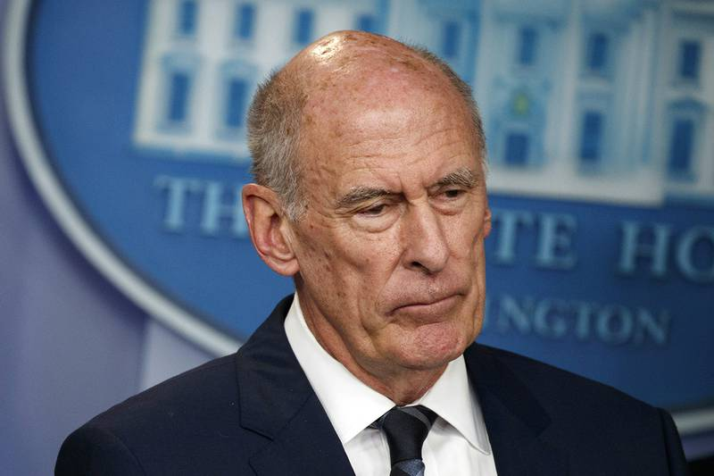 In this Aug. 2, 2018, file photo, Director of National Intelligence Dan Coats listens during a daily press briefing at the White House in Washington.